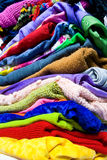 Pile of colorful clothes Stock Images