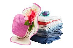 Pile of colorful clothes and Beautiful summer hat ,sweet beautif Royalty Free Stock Photo