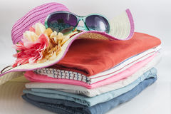 Pile of colorful clothes and Beautiful summer hat ,sweet beautif Royalty Free Stock Images