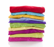 Pile of colorful clothes over white background Stock Photography