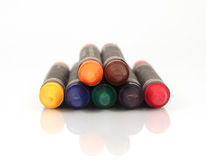 Pile of colorful crayons Stock Photos