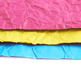 Pile of colorful crumpled sheets. Of origami paper, close-up crop as an abstract background composition stock photo