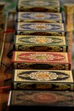Pile of colorful, decorative Quran books Royalty Free Stock Photos