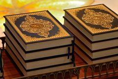 Pile of colorful, decorative Quran books Royalty Free Stock Images