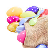 Pile of colorful easter eggs in pouch Stock Photography