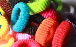 A pile of colorful elastic hair bands with side lighting. Royalty Free Stock Photo