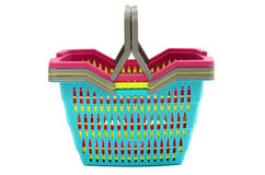 Pile of colorful empty plastic shopping baskets. Royalty Free Stock Photos