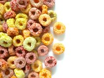 Pile of colorful fruity breakfast cereal. Isolated on white background. Top view royalty free stock photography