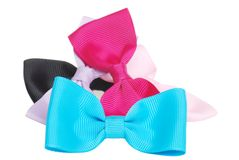 Pile of colorful hair bows. Isolated pile of colorful hair bows on white background stock photos