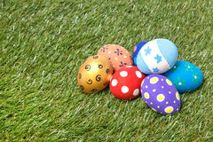Pile of colorful handmade easter eggs on grass. Pile of colorful handmade easter eggs on green grass Royalty Free Stock Photos