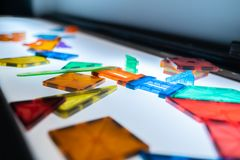 Pile of colorful kid blocks on a table. royalty free stock images