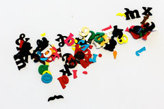 Pile of colorful little letters over white Royalty Free Stock Photos
