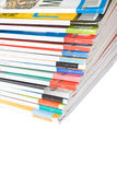 Pile of colorful magazines. Isolated over white background Stock Images