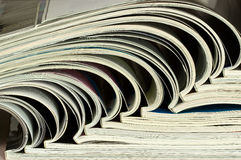 Pile of colorful magazines on a table. In the library Royalty Free Stock Images