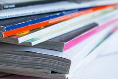 Pile of colorful magazines on a table Royalty Free Stock Photography