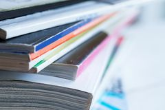 Pile of colorful magazines on a table Stock Photos