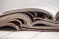 Pile of colorful magazines on a table Royalty Free Stock Image
