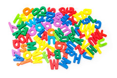 Pile of colorful magnetic letters. Pile of colorful magnetic upper and lowercase letters, white background Stock Photos