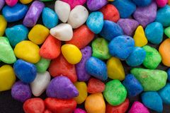 Pile of colorful pebbles as a stone background Stock Photo