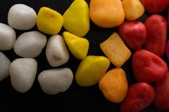 Pile of colorful pebbles as a stone background Stock Photography