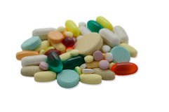 Pile of colorful pills fading to blur Royalty Free Stock Images