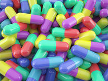 Pile of colorful pills lying on the floor Royalty Free Stock Photos