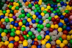 A pile of colorful plastic balls stock images