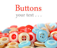 Pile of colorful plastic buttons Royalty Free Stock Images