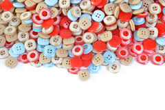 Pile of colorful plastic buttons Stock Images