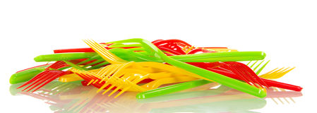 Pile of colorful plastic forks isolated on white background. Stock Photography