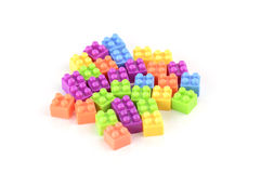 Pile of colorful plastic toy bricks  on white background Stock Photos
