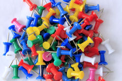 A Pile of Colorful Push Pins on a White Background Royalty Free Stock Photography