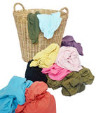 Pile of colorful shirts in a wicker basket Stock Photos