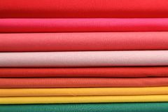 Pile of colorful t-shirts, close up. View Stock Image