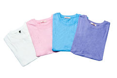 Pile of colorful t-shirts freshly. Folded from the laundry isolated on the white background Royalty Free Stock Photography