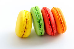 Pile of colorful and tasty french macaroons on white background Stock Photos