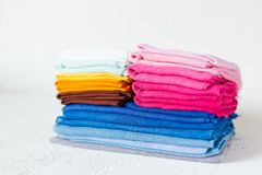 Pile of colorful textile swatches on white background stock images