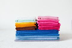 Pile of colorful textile swatches on white background royalty free stock image