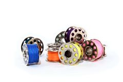 Pile of colorful thread spools Royalty Free Stock Photography