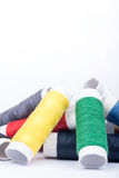 Pile of colorful threads over white background Stock Photos