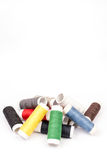Pile of colorful threads over white background Royalty Free Stock Images