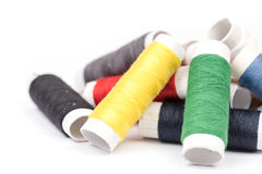 Pile of colorful threads over white background Stock Image