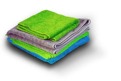 Pile of colorful towel on white Stock Images