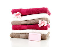 Pile of colorful towels and soap Stock Photo