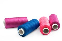 Pile of coloured bobbins of lurex thread Royalty Free Stock Image