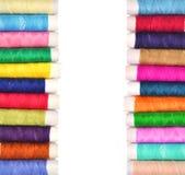 Pile of coloured bobbins of lurex thread isolated on white Royalty Free Stock Photos