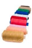 Pile,coloured bobbins of thread Stock Photo