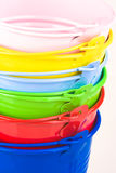 Pile of coloured buckets royalty free stock images