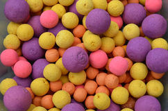 Pile of Coloured Carp Coarse Fishing Tackle Popup Bait Royalty Free Stock Photo