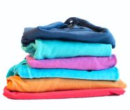 Pile of coloured clothes from the laundry Royalty Free Stock Photography